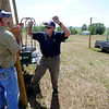 "Geoff Hess, left, jokes with his dad, Fred, while they and Kyle DiGiacomo work on the hops field.<br /> The site, combined with the brewery and restaurants, make up a triangle of sustainability for the local craft brewer.<br /> For a video of the farm, go to  <a href=""http://www.dailycamera.com"">http://www.dailycamera.com</a>.<br /> Cliff Grassmick / July 8, 2011"