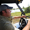 "Geoff Hess rides out to work on the hops field.<br /> The site, combined with the brewery and restaurants, make up a triangle of sustainability for the local craft brewer.<br /> For a video of the farm, go to  <a href=""http://www.dailycamera.com"">http://www.dailycamera.com</a>.<br /> Cliff Grassmick / July 8, 2011"