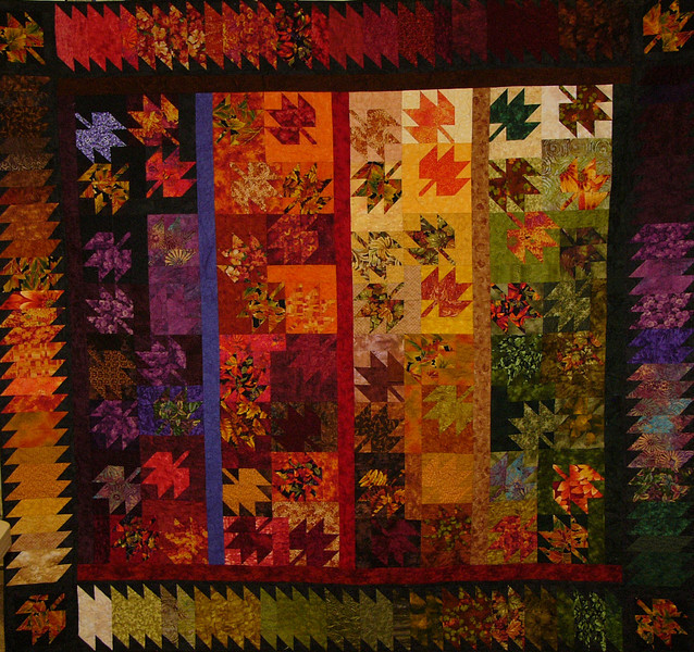 """Scrappy Leaves by Corinne Schroeder<br /> <br /> Kit,book,and class available<br /> <br /> 70 different fabrics provide variety and interest to this scrappy pattern.  Using 2 1/2"""" strips and a sew and flip method this quilt goes together in no time."""
