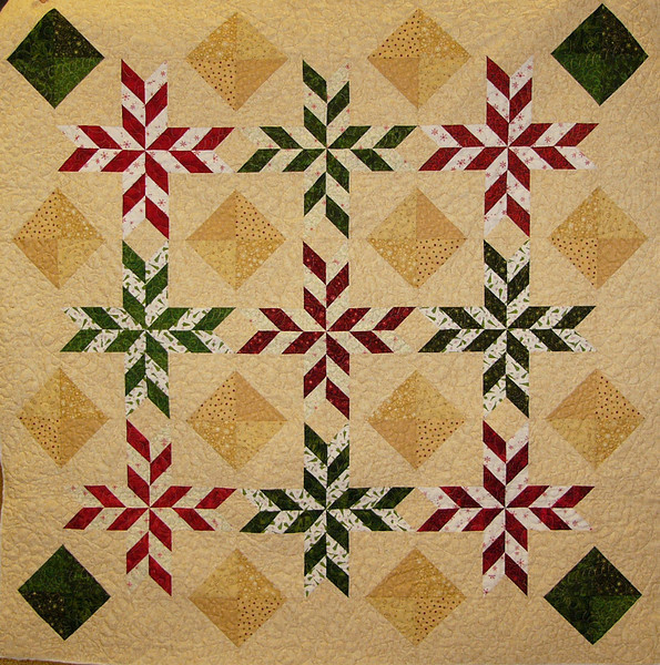 Peppermint Twist by Ruth Biehl<br /> <br /> Kit,pattern and class available<br /> <br /> This is a fat quarter quilt that uses a chevron pattern and squares turned on point.  Make this in time for Christmas.