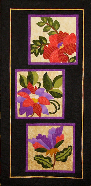 Floral Flambouance by Corinne Schroeder<br /> Beginning Machine Applique Class<br /> Kit and book available<br /> Broaden your quilting abilities to include appliqué. This class will teach the basic techniques for machine appliqué that will enable you to create many of the quilts displayed in our shop.