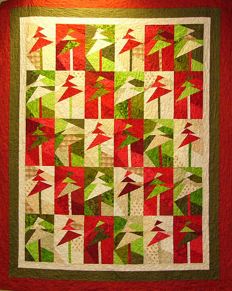 Tree's Up, Lights on by Aimee Griffin<br /> Stack them, slash them, mix and sew!<br /> Pattern, kits and class available.