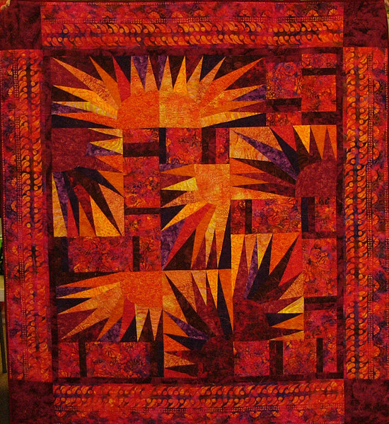 Fire Fly by Corinne Schroeder<br /> <br /> Kits, books and class available<br /> <br /> This quilt is a combination of straight and paper foundation piecing. Corinne used one of our new batik border prints in her border to pull the quilt together for a finished look.