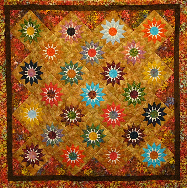 Shooting Stars with Ruth Biehl<br /> pattern,fabric, and class available<br /> Wait till you see the quilting on this quilt.