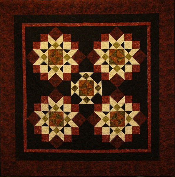 Ticonderoga Star by Karen Gleiche<br /> Kit,pattern and class available<br /> <br /> Beautiful in batiks. Take three blocks and blend it into one traditional quilt.