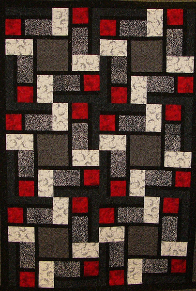 Lacy's Way Quilt. Pieced by Margie Hooper. Quilted by Kay Giese.<br /> Pattern and fabrics at the shop.