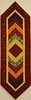 "Braided Table Runner by Ruth Biehl<br /> <br /> Pattern and class available<br /> <br /> This table runner will be done by the time you leave the class. This is a ""quilt as you go"" method. One jelly roll will complete 4 table runners. Perfect for hostess gifts."