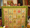 1000th quilt by Megan Shein. Quilted by Kay Geise (on right).
