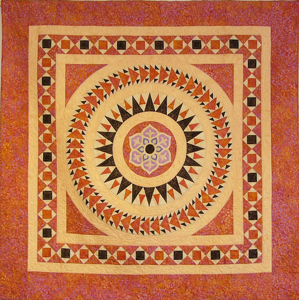 Cosmoti Rings II by Ruth Bielh<br /> This is another Bella Bella Quilt.<br /> book and Class available