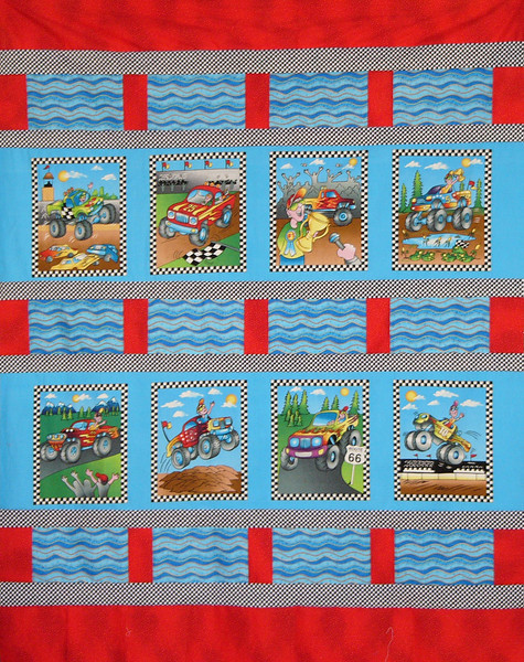 Here's a cuddle quilt that Starlette McCollum is working on, using 3 fabrics and a truck panel. all available while supplies last at the shop.