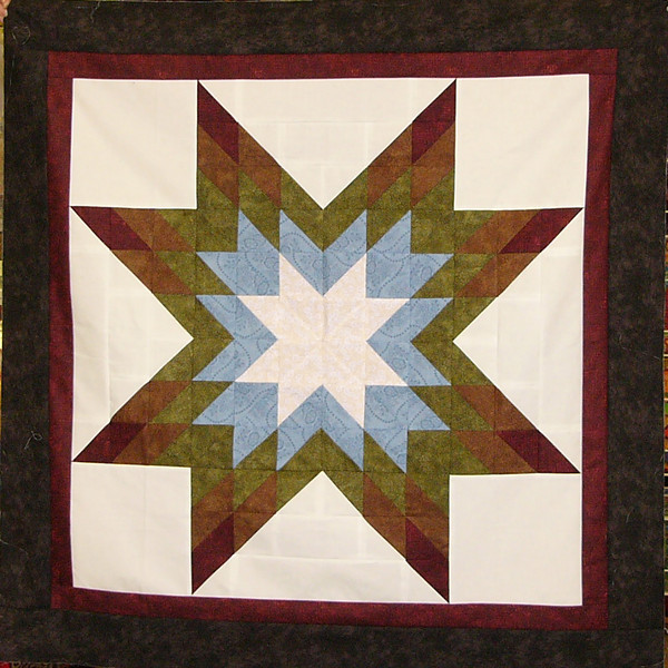 Shining Star by Ruth and Aleck Biehl<br /> pattern,and fabrics available while supplies last