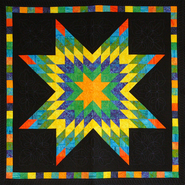 Corinne's Lone Star. A collaboration between Corinne and Aimee.<br /> No y seams in this pattern, the easiest lone star pattern you'll ever make.<br /> Pattern found only at Overall Quilter.