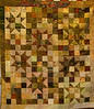 Overall Stars in Batiks. Quilt made by Corinne Schroeder