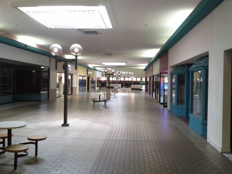 Completed in 1983, the Palatka Mall never materialized to the full potential or dreams it shared for the community.With the development of the Mall on the outskirts of town the community moved west and away from the downtown business area. After a time the mall struggled to find regular clients for its stores and has since become a quasi-goverment service center. The mall still has some stores to include a Dollar General, 2 jewelery stores, a movie cienma, a few clothing stores as well as anchor stores of Goody's and a JC Pennys but the biggest part of the mall is government offices. Tax Collector, Unmployment Office, Military Recruiters and a few others. The Mall interior has been renovated 2 or 3 times to reflect it's new nature. It currently has a central courtyard with a water fountain and planters as it's centerpiece.