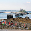 Fort Foster Beach - Kittery Point, Maine -- A group of kids on the beach with the former life saving station on Woods Island (Piscataqua River) in the background. (c) Tom Croke/Visual Image Inc.