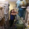Perfectly Placed for You's warehouse in Billerica, where furniture and other items for house staging are stored. Co-owners Liz Larson, left, and Jan Poulain, both of Chelmsford, in their pillow room. (SUN/Julia Malakie)