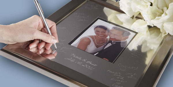 Engravable Signature Photo Mats - Frame included.  You sign it with a special engraving pen, signatures will not fade and are permanent.