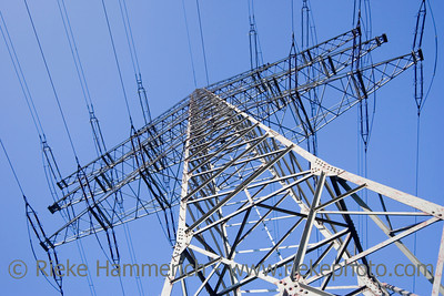 solitary electricity pylon - against a blue sky - adobe RGB