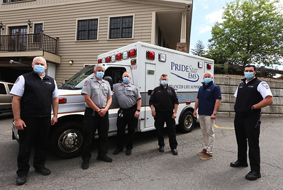 From left, Pridestar EMS paramedic and director of operations John Hebert of Lowell, paramedic Greg Eckelkamp of Chelmsford, EMT Jim Jensen of Dracut, paramedic Ron Dostie of Ayer, CEO David Daly of Lowell, and EMT Bryan Black of Nashua, at the company's headquarters on Stedman Street in Lowell. (SUN/Julia Malakie)
