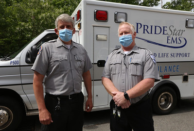 Pridestar EMS paramedic Greg Eckelkamp of Chelmsford, left, and EMT Jim Jensen of Dracut, who work as a team, at the company's headquarters on Stedman Street in Lowell. (SUN/Julia Malakie)