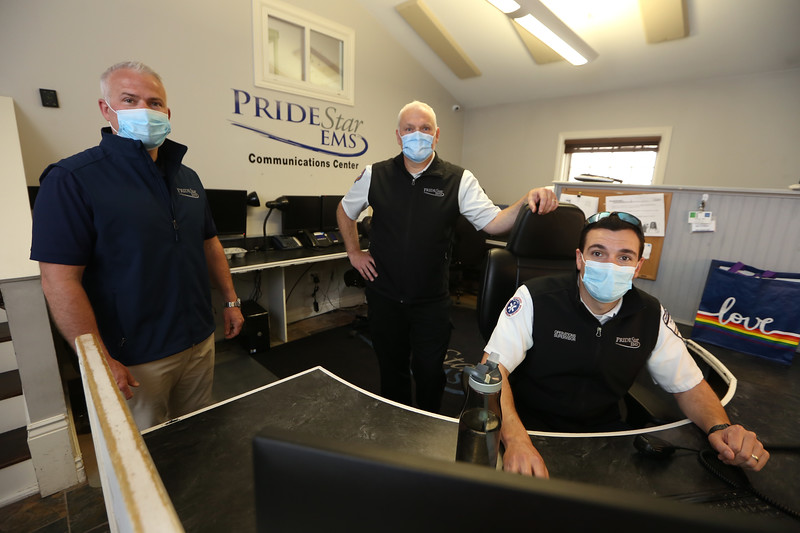 From left, Pridestar EMS CEO David Daly of Lowell, paramedic and director of operations John Hebert of Lowell, and EMT Bryan Black of Nashua, at the company's headquarters on Stedman Street in Lowell. (SUN/Julia Malakie)