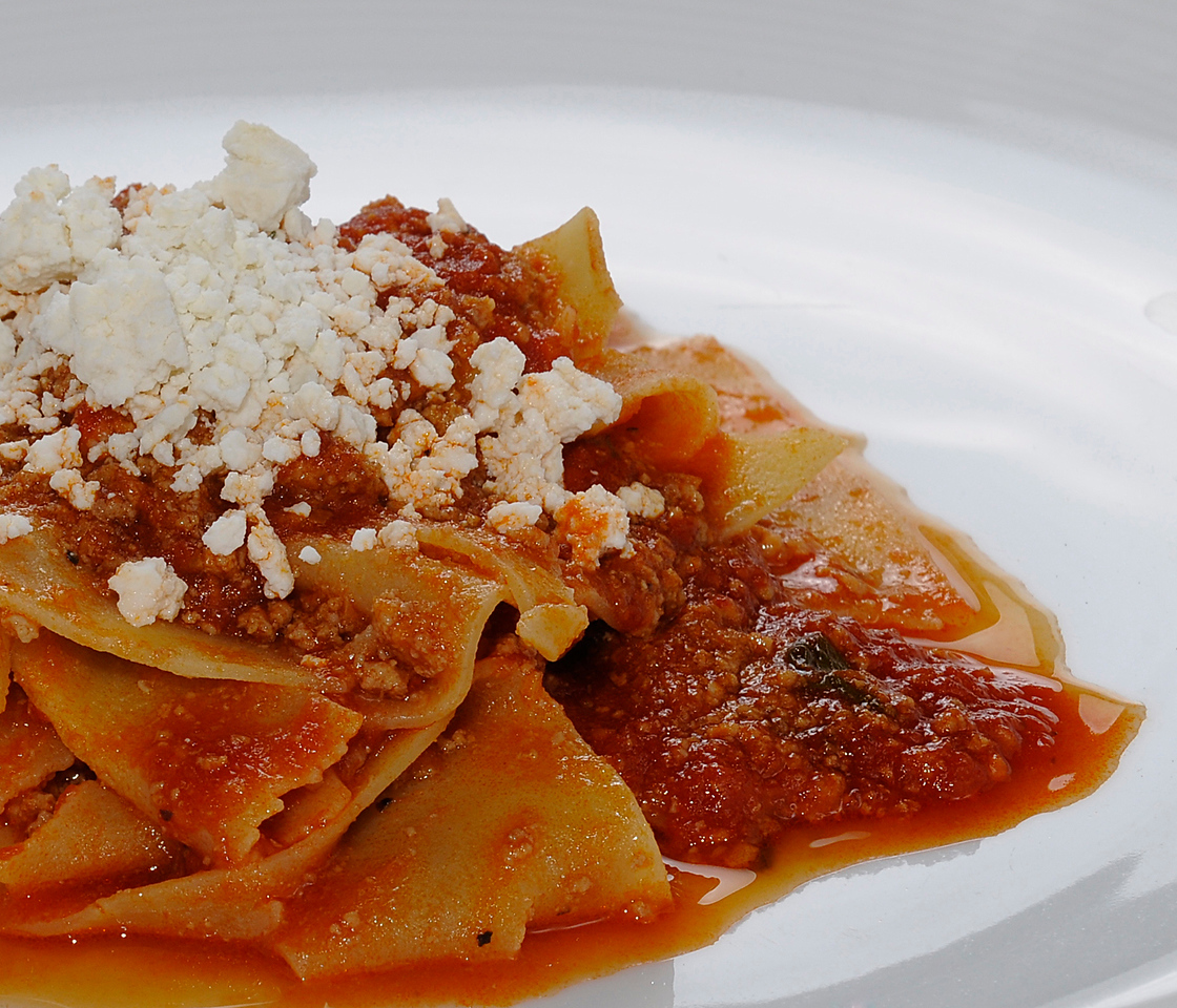 Pappardelle served with a ragù of tomato, ground beef, veal & pork topped with ricotta salata