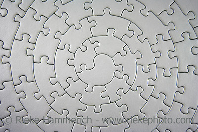 complete grey jigsaw wide angle - pieces fitting together in form of a spiral - adobe RGB