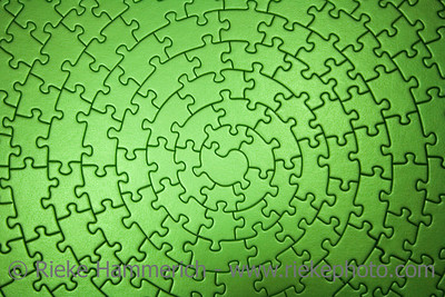 complete green jigsaw wide angle - pieces fitting together in form of a spiral - adobe RGB