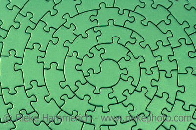 complete green jigsaw - pieces fitting together in form of a spiral - adobe RGB