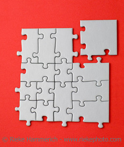 grey jigsaw with the missing piece laying aside - in form of a square - adobe RGB