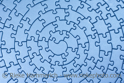 complete blue jigsaw - pieces fitting together in form of a spiral - adobe RGB