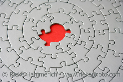grey jigsaw with one missing piece - focus is on the hole - adobe RGB