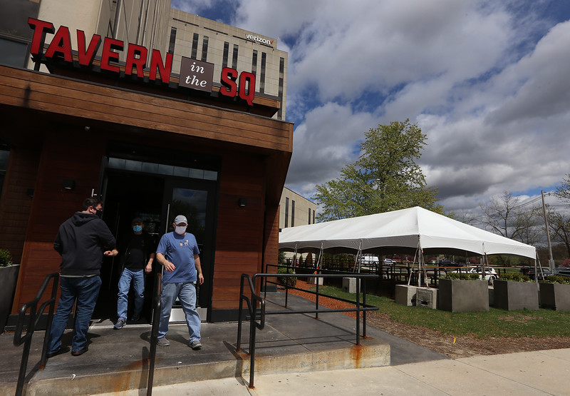 Tavern in the Square restaurant, at Cross Point in Lowell. Business is coming back after the downturn due to the Covid-19 pandemic. The outdoor tent dining area has 15 tables that seat six comfortably, the maximum currently allowed. JULIA MALAKIE/LOWELLSUN