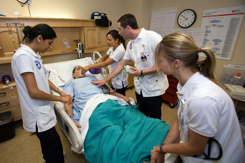 Sacramento City College Extended Campus nursing students (from L) Manpreet Kaur, Rebecca Peirce, Brian Bangs and Natasha Maier participate in a CVA simulation exercise in the SCC/EX sim lab.