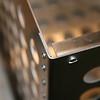 New corner design.  316 SS pop rivets replace welded seam.