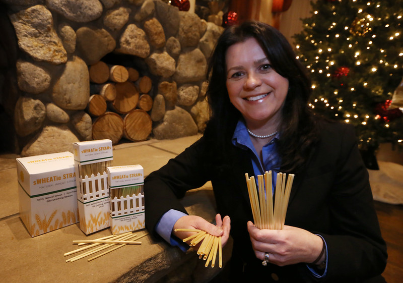 Tewksbury resident and entrepreneur Anne-Marie Maguire is marketing sWHEATie straws, compostable drinking straws made from wheat stalks, which are hollow. (SUN/Julia Malakie)