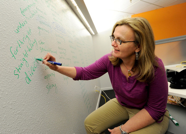 """Mary Fuka,  a freelance physicist from Inphysica, brainstorms on the board at Scrib.<br /> Scrib, a new coworking space in Boulder, is hosting the Lean Startup Machine workshop, which is being held in conjunction with Boulder Startup Week. For more photos of Scrib, got to  <a href=""""http://www.dailycamera.com"""">http://www.dailycamera.com</a>.<br /> Cliff Grassmick / May 10, 2012"""
