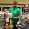 Lyndie Shaw and her brother Mark Shaw, both of Dracut, with some of the milk and other products people can order from Shaw Farm. Deliveries are more in demand due to the Covid-19 pandemic. (SUN/Julia Malakie)