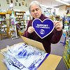 KRISTOPHER RADDER — BRATTLEBORO REFORMER<br /> Pat Fowler, owner of Village Square Booksellers, in Bellows Falls, pulls out some of the advertising merchandise for Small Business Saturday on Monday, Nov. 19, 2018.
