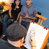 Guests at Sigmas Open House Getting Caricature in Lounge