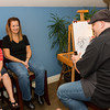 Guests in Lounge Getting Caricature Drawing