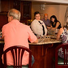 Guests at Sigmas Open House in Dining Room with Kimberly Bartender