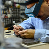 KRISTOPHER RADDER - BRATTLEBORO REFORMER<br /> Lamont Barnett, co-owner of Rock and Hammer in Bellows Falls, repairs a watch on Thursday, Nov. 16, 2017. Rock and Hammer and other stores in Bellows Falls are participating in Small Business Saturday on Nov. 25, 2017.