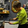 KRISTOPHER RADDER - BRATTLEBORO REFORMER<br /> Pam Parant, co-owner of Rock and Hammer in Bellows Falls, works on a hammered silver cuff on Thursday, Nov. 16, 2017. Rock and Hammer and other stores in Bellows Falls are participating in Small Business Saturday on Nov. 25, 2017.