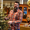 KRISTOPHER RADDER - BRATTLEBORO REFORMER<br /> Jon Midura, a manager at Windham Antiques, hangs an antique ornament on a tree on Thursday, Nov. 16, 2017.