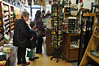 Jesse Brazee, 8, of Florida, and Marylou Beaudin, of Adams, look at post cards at Berkshire Emporium & Antiques on Saturday, Nov. 30, 2013.. (Jack Guerino/North Adams Transcript)