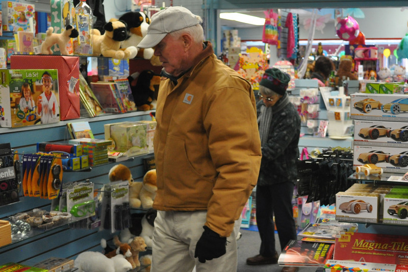 Dick Blake, from Williamstown, looks at the many toys in Persnickety Saturday. (Jack Guerino/North Adams Transcript)
