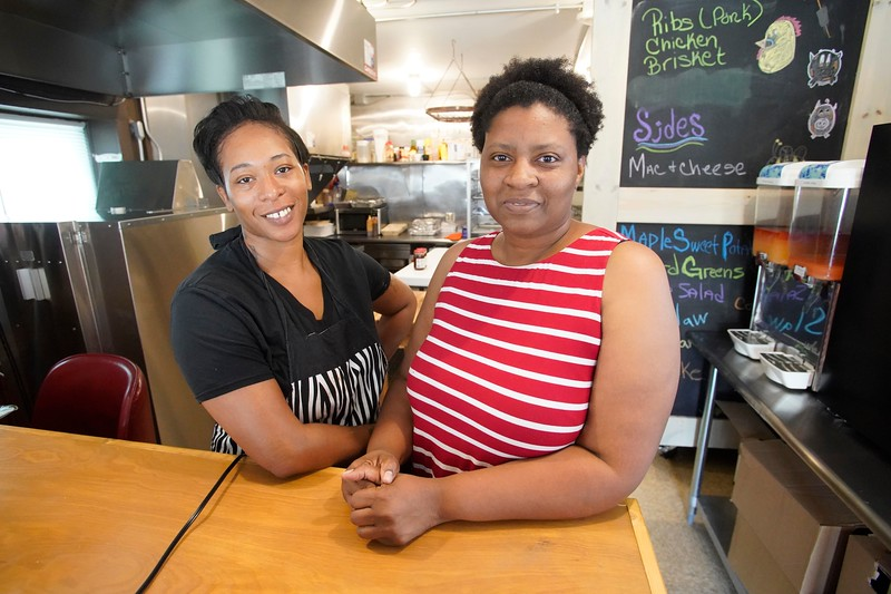 BEN GARVER — THE BERKSHIRE EAGLE<br /> Geneva Samuel and Lorraine Jones work the magic behind the counter at Smokey Divas. Lorraine Jones has opened Smokey Diva's, a new barbecue restaurant at  239 Onota Street in Pittsfield.  Jones is using a family recipe that has been very successful in the Bay Area.
