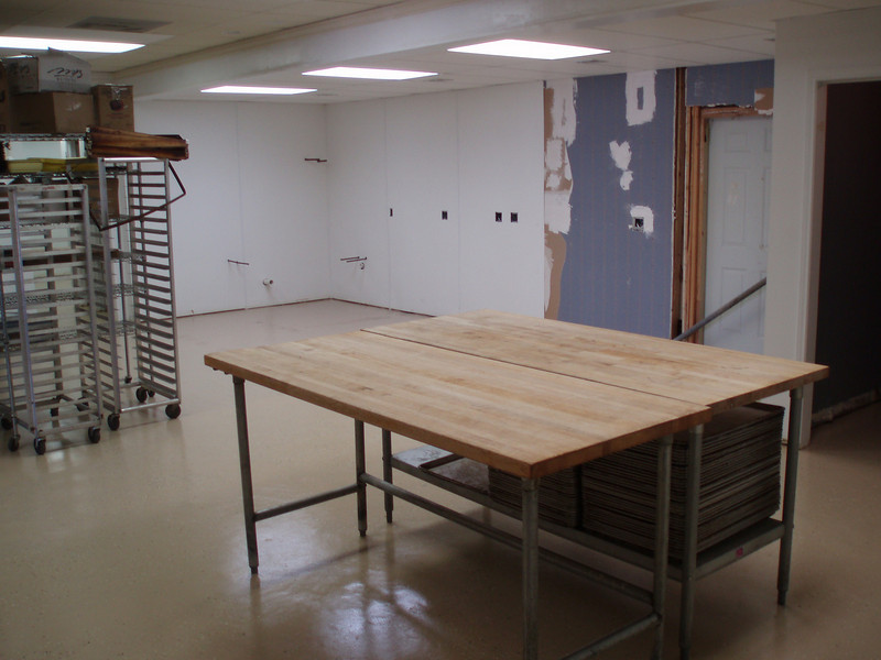 May 26, 2008: The kitchen floor is painted and sealed. We moved the 1st pieces of bakery equipment in. The clock is ticking.