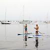 Paddleboarding across the harbor in Watch Hill, RI.<br />  (c) Tom Croke/Visual Image Inc.